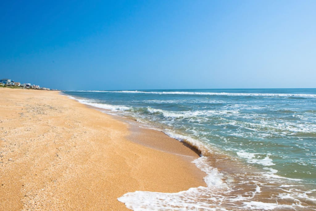 Stroll along the pristine beach which is just 8 houses away.