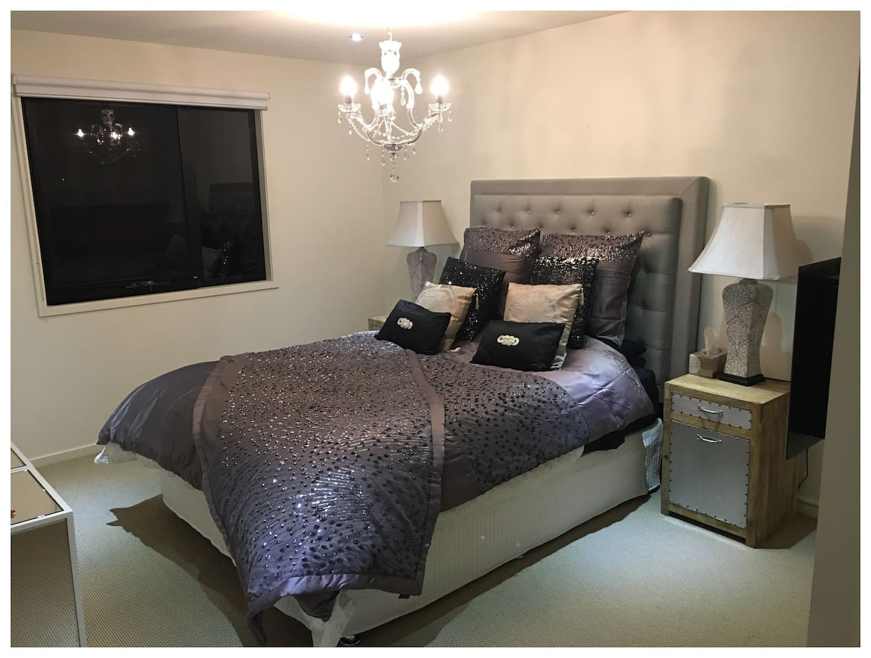 Master Bedroom styled with Kylie Minogue bedding and electric fireplace