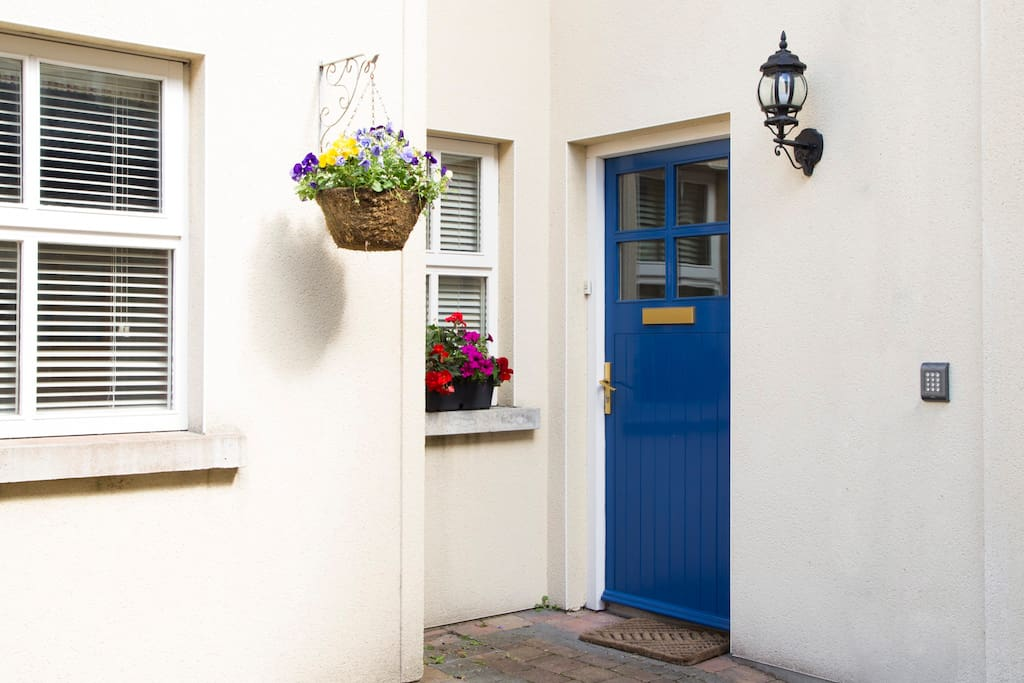 Front door on to shared courtyard of 4 houses