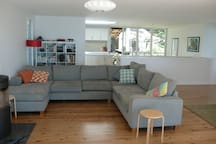 Huge light filled kitchen, dining, living areas front onto Pittwater and back onto bushland