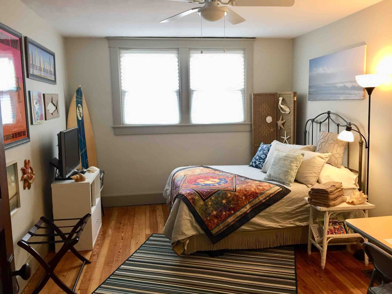 The 10x15 Surf Room is your hideout in Indianapolis. The comfy full-size bed is surrounded with some of my surfing and beach memorabilia. There's a fridge, microwave, TV, VHS player, VHS movies, record player, records, 2 chairs, and a desk.