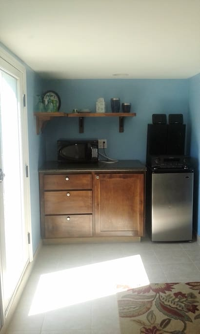 Includes mini fridge, microwave and hot water kettle.