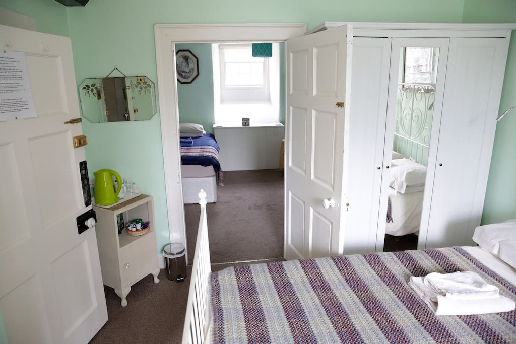 Adjoining room with two single beds