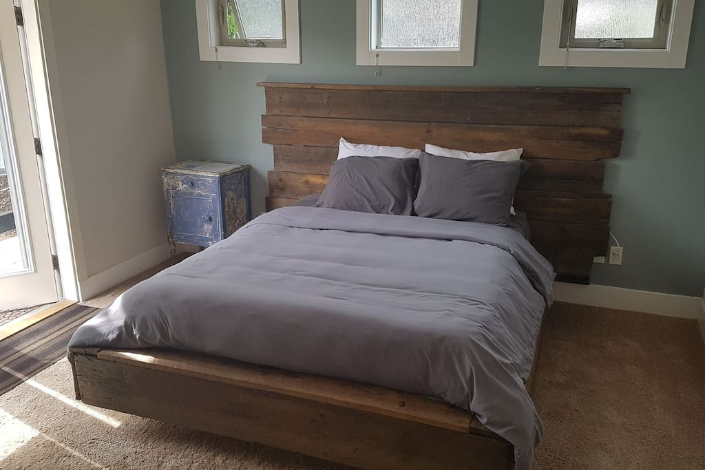 comfortable queen bed with hand made bed frame