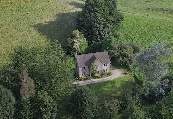 Large Cotswold farmhouse with panoramic views
