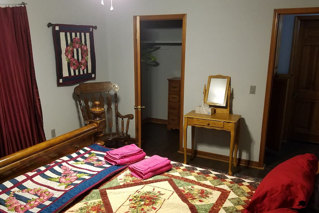The Rose Room has a queen sized bed and two windows. It also has a large walk-in closet.