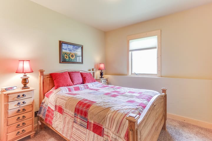 Queen bedroom with adjacent bath and rec room