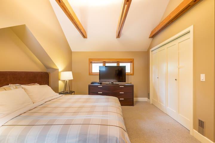 Second-floor master bedroom with queen bed