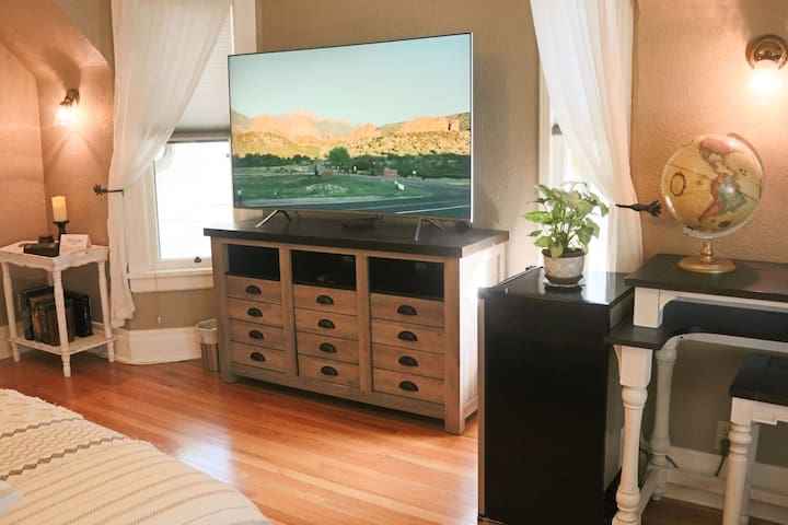 Your 64-inch HD 4k curved television awaits your command.