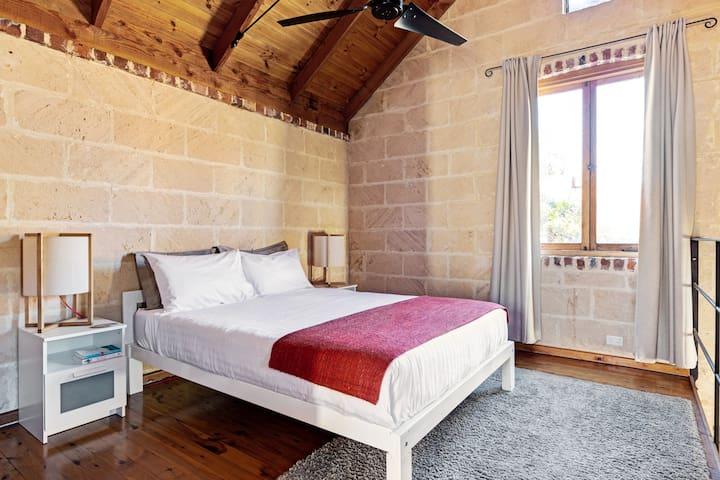 Upstairs main Loft Bedroom with queen bed. Has ceiling fan and light operated via a remote control