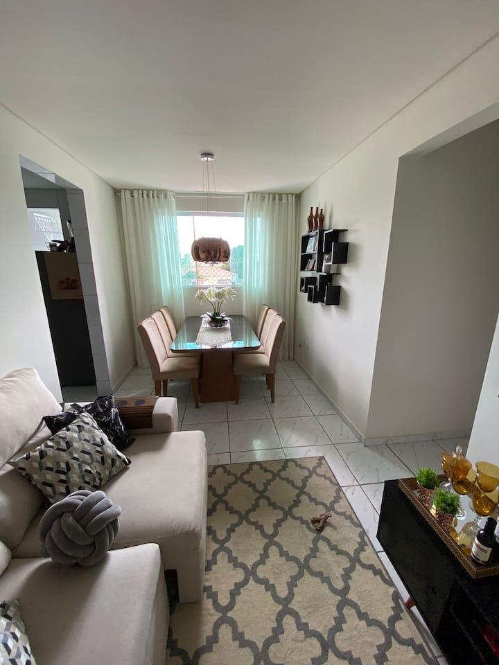 Quarto em apartamento moderno e aconchegante