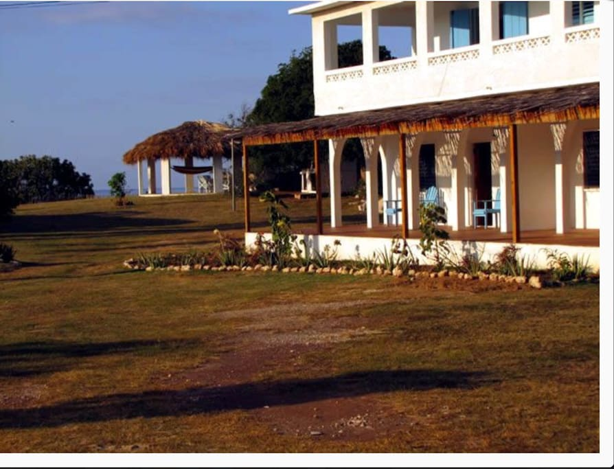 View of suite and gazebo with ocean view and steps to beach.