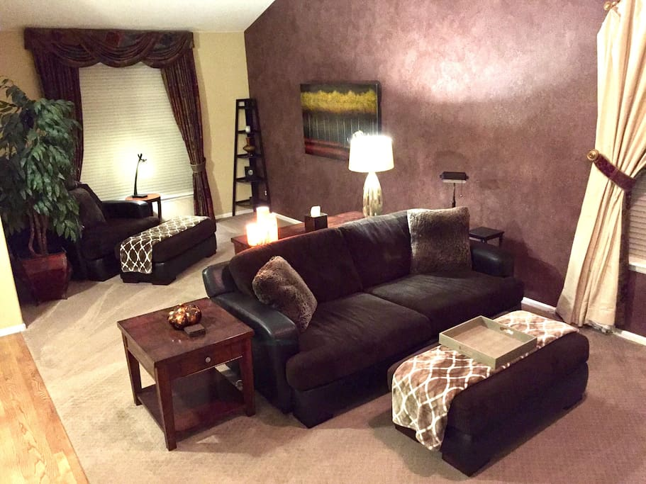 Main floor family room has flat TV and comfortable seating.