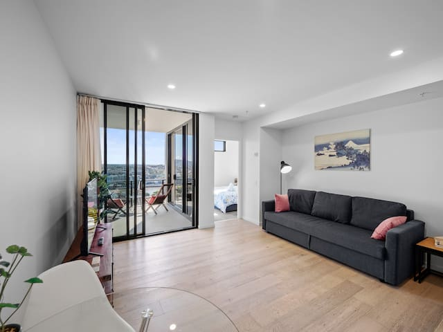 """Bright and cozy living room with 50"""" smart tv."""