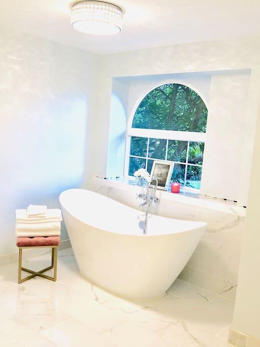 Spa-like bathroom, in white simplicity.