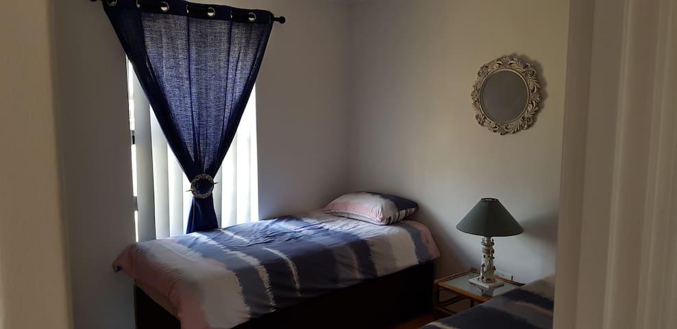 Bedroom 2 - 2x single beds