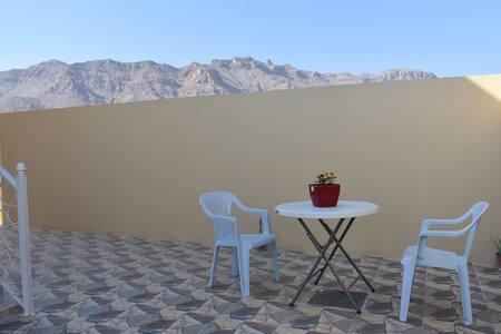 Private room, entrance and patio in Omani Villa