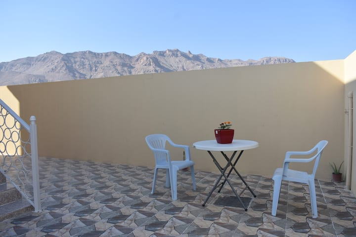 Private room, entrance and patio in Omani Villa
