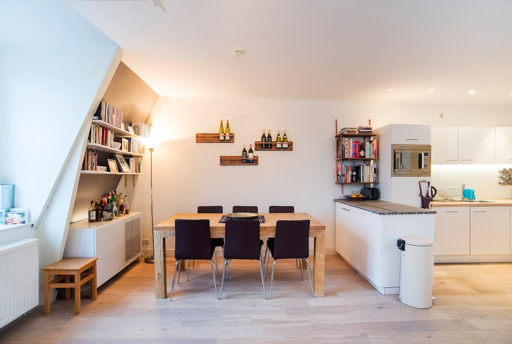 Open-plan, airy and light - the living area, dining area and kitchen
