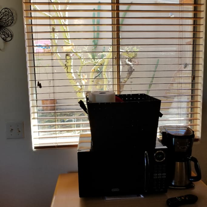 Window view to the Zen Garden with a basket of kitchen utilities for cooking