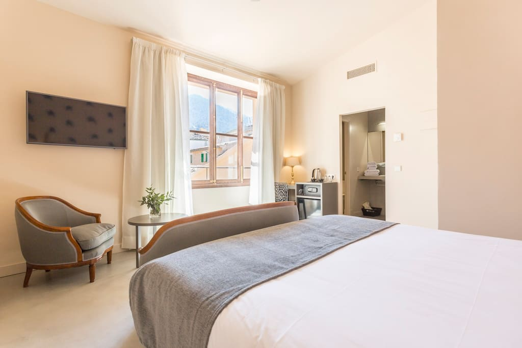 The bedroom comes with a Smart TV and lovely views over the village.