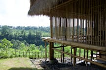 Exterior of the Panorama Room and the kitchen below overlooking Ayung River gorge.