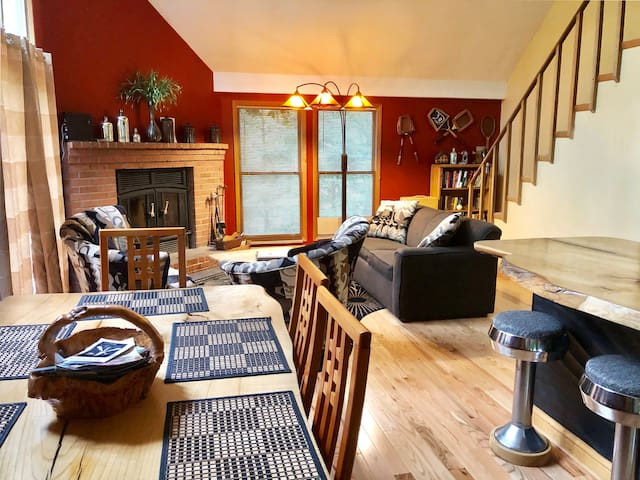 Spacious living room and dining room, with a wood-burning fireplace.