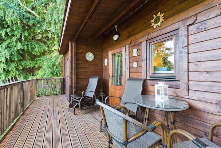 Luxury woodland cabin retreat, private escape.