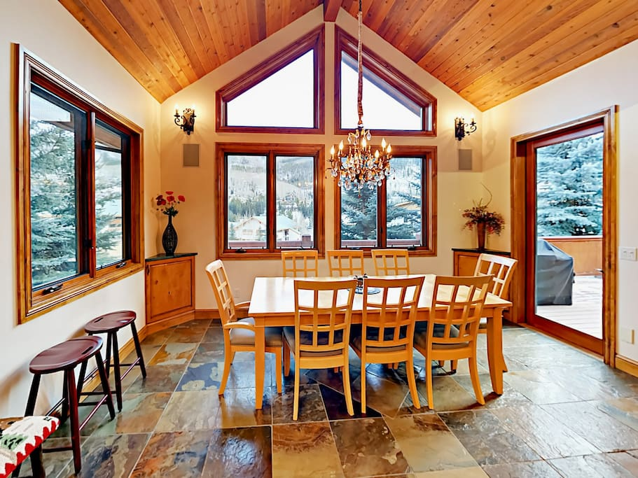 8-person dining table with lovely forested views and sliding doors to the deck.