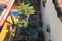 Patio / pool area, as seen from above (from upstairs master bedroom window)