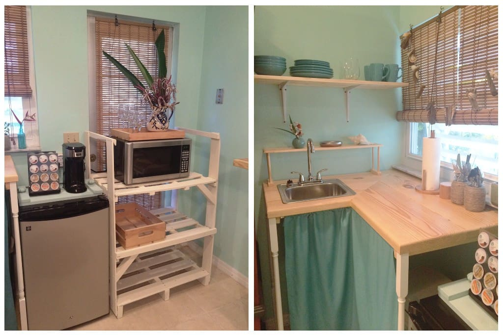 Kitchenette area with mini-fridge, microwave, coffee maker, sink, dishware, and silverware.