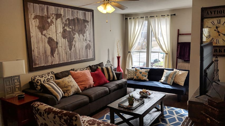 Very cozy living room with couch, futon, and over-sized chair