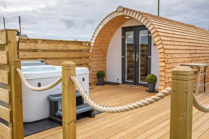 Luxurious Pod with Hot Tub and decking area.
