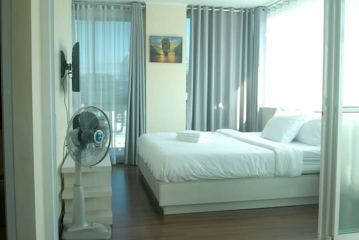 Bedroom with air con, kingsize bed and sliding doors