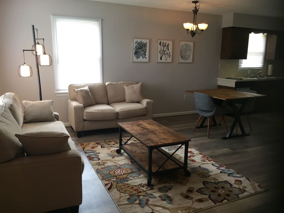 Gorgeous open floor plan with updated and stylish furniture, small dining table and chairs, Dish Network and WIFI