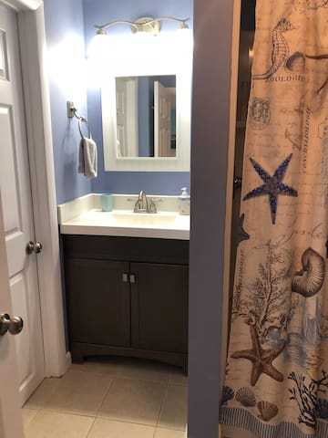 Small bathroom with stall shower.  (Closet in photo is locked and for owner's use only)