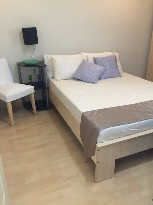 Full size bed on the bedroom