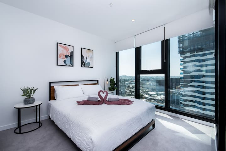 Air-conditioned master bedroom with ultra comfy queen bed, extra large wardrobes and deluxe private ensuite