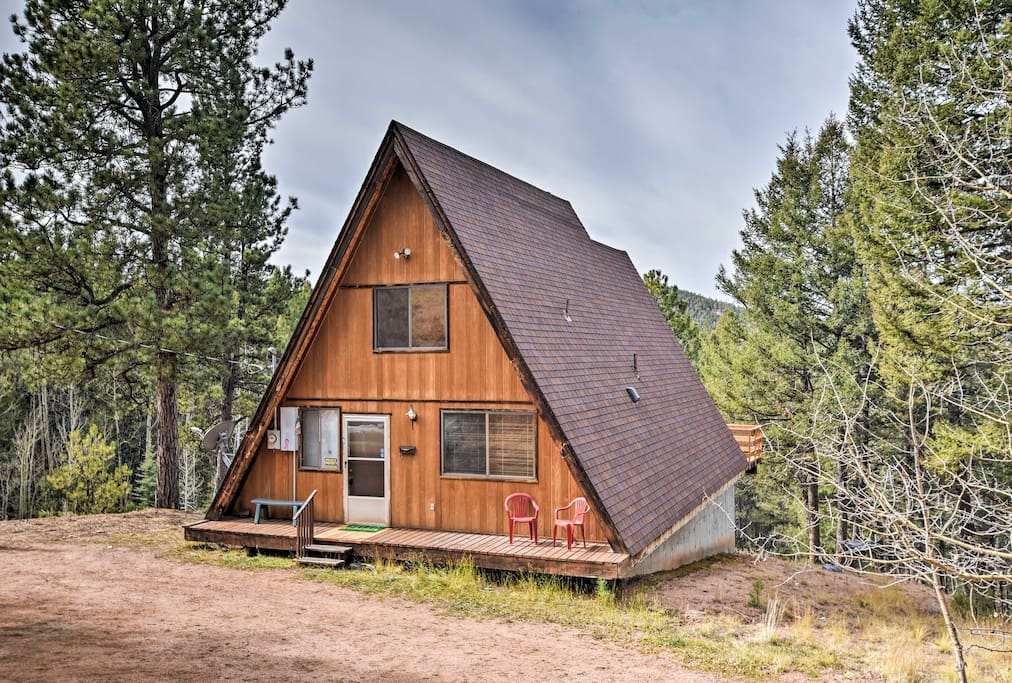 This cozy A-frame cabin is secluded in the woods and offers fabulous views.