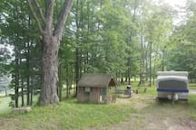 This picture shows the campsite with kids play house and swings.