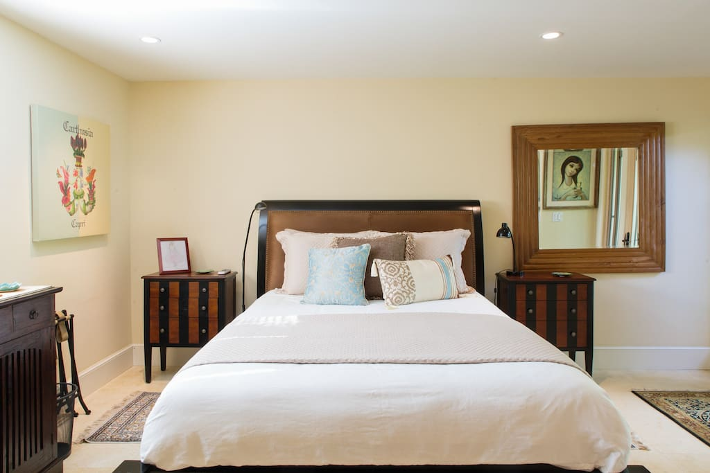 Queen size bed, delicately furnished room to give you an open, spacious feeling.