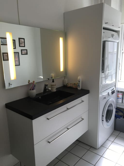Bathroom with sink, washer and dryer