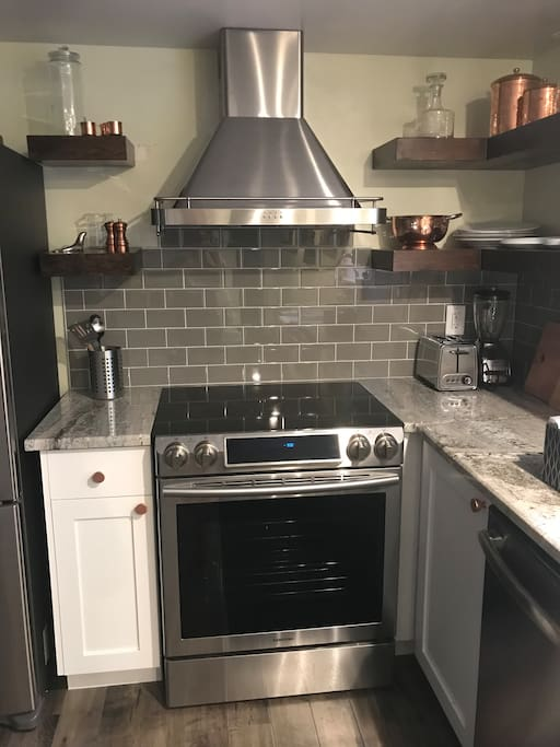 Brand new stove with a fast boil flat top cooking range.