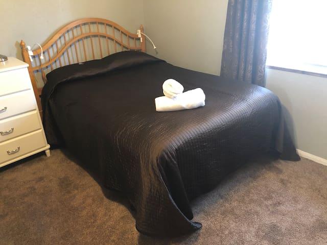 Queen bed in the front bedroom.