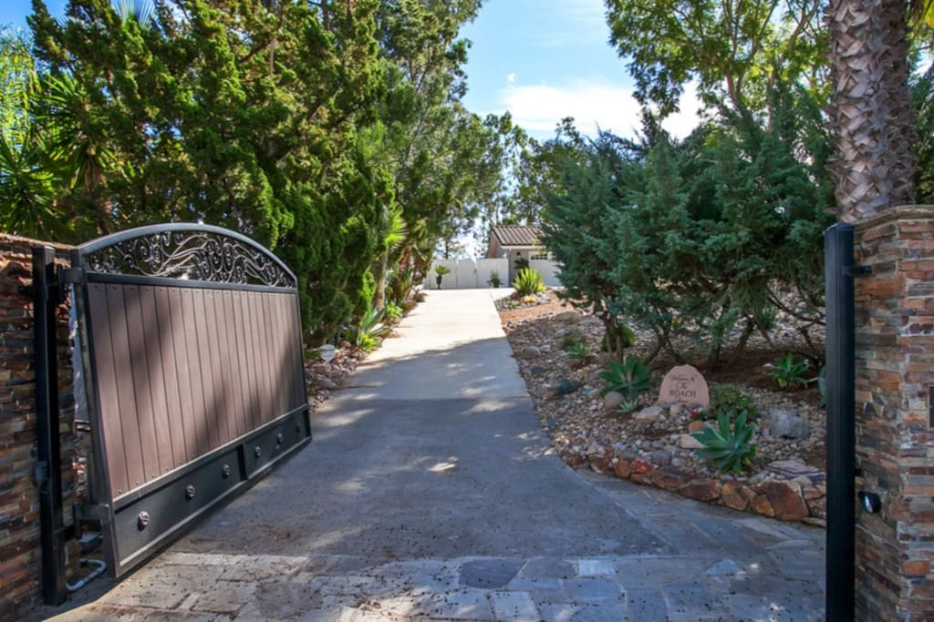 Grand gated entry 1 acre property
