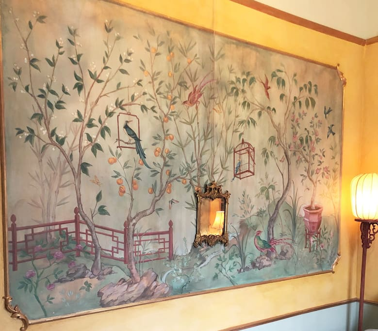 The chinoiserie mural on the bedroom wall
