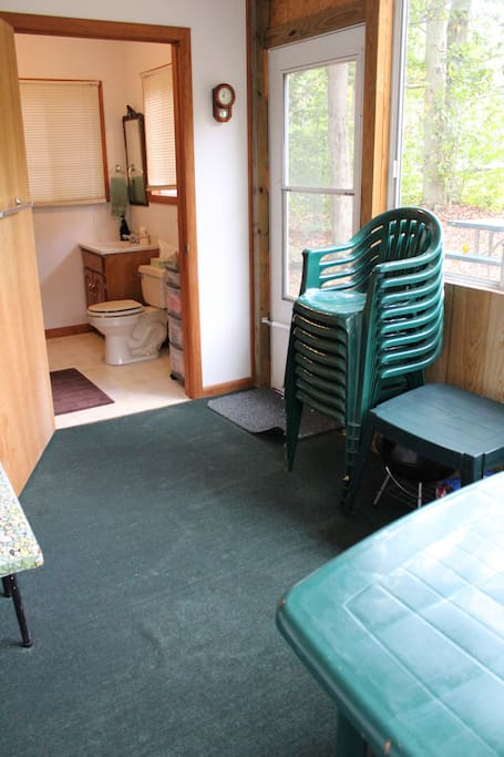 Screened in back porch with full bathroom