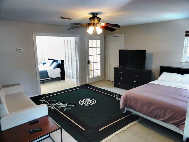 The upstairs living room is great for socializing/relaxing during the day, yet provides ample sleeping space at night.