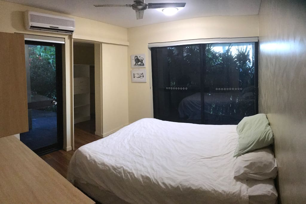 Master bedroom with queen bed, secluded and surrounded by garden.