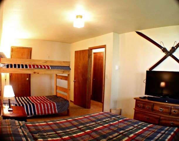 Ezra's Room (bdrm 2 ds) is a  large room with a queen and bunk bed. There's also a tv and game system